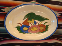 Mexican vintage pottery and ceramics, a beautiful oval platter decorated with a very lovely bird and flowers, Talquepaque, Jalisco, c. 1930-40's. Main photo of the front of the oval platter.