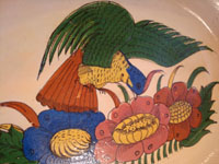 Mexican vintage pottery and ceramics, a beautiful oval platter decorated with a very lovely bird and flowers, Talquepaque, Jalisco, c. 1930-40's. Closeup photo of the lovely bird.