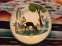Mexican vintage pottery and ceramics, a lovely plate with a cream-colored background glaze and a wonderful and very serene scene of a burro munching grass under graceful trees and foliage, Tlaquepaque, Jalisco, c. 1930's.  Main photo of the front of the plate.