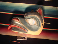 Native American Indian wood-carving and folk art, a Northwest Coast carved wooden miniature mask in the form of a bear with abalone inlaid eyes, signed LAVALLE, c. 1960's. Photo showing a side of the mask.