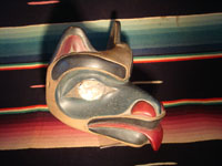 Native American Indian wood-carving and folk art, a Northwest Coast carved wooden miniature mask in the form of a bear with abalone inlaid eyes, signed LAVALLE, c. 1960's. Photo showing the second side of the miniature mask.