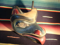 Native American Indian wood-carving and folk art, a Northwest Coast carved wooden miniature mask in the form of a bear with abalone inlaid eyes, signed LAVALLE, c. 1960's. Another view of the front side of the mask.