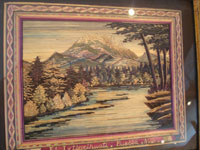 Mexican vintage straw-art (popote art or popotillo), a wonderful straw-art scene, created using thousands of minute pieces of dyed straw (popote, in Spanish) of a lake with a majestic volcano in the background, c. 1930-40's. Photo of the actual popote picture.