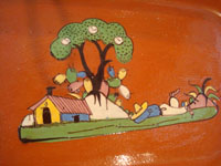 Mexican vintage pottery and ceramics, a beautiful rectangular dish with an earthen-colored (reddish) glaze background and a wonderful rural scene, Tlaquepaque, Jalisco, c. 1940's. Closeup photo of the central design of the dish.