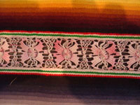Mexican vintage textiles and sarapes, a spectacular Saltillo sarape with bands of tela deshilada (threads are removed and lovely flowers are then created with the remaining threads), c. 1920-40. This is an extremely rare and beautiful Mexican textile.  Closeup photo of one band of the sarape, showing the tela deshilada.