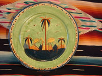 Mexican vintage pottery and ceramics, a wonderful plate with a rare, pale-green background glaze and a beautiful scene with two graceful birds (egrets or cranes), Tlaquepaque, Jalisco, c. 1930's. Main photo.