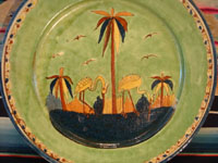 Mexican vintage pottery and ceramics, a wonderful plate with a rare, pale-green background glaze and a beautiful scene with two graceful birds (egrets or cranes), Tlaquepaque, Jalisco, c. 1930's. Another view of the front of the plate.