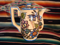Mexican vintage pottery and ceramics, a beautiful coffee pot with a cream-colored background glaze and exquisite floral decorations, Tlaquepaque, Jalisco, c. 1940's. Main photo.