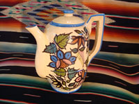 Mexican vintage pottery and ceramics, a beautiful coffee pot with a cream-colored background glaze and exquisite floral decorations, Tlaquepaque, Jalisco, c. 1940's. The second side of the coffee pot.