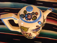 Mexican vintage pottery and ceramics, a beautiful coffee pot with a cream-colored background glaze and exquisite floral decorations, Tlaquepaque, Jalisco, c. 1940's. Photo from above the pot looking down at the lid.