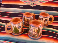 Mexican vintage pottery and ceramics, a set of four mugs with petatillo backgrounds and wonderful artwork, attributed to the famous artist, Balbino Lucano, Tlaquepaque, Jalisco, c. 1930. Main photo showing all four mugs.