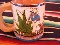 Mexican vintage pottery and ceramics, a set of four mugs with petatillo backgrounds and wonderful artwork, attributed to the famous artist, Balbino Lucano, Tlaquepaque, Jalisco, c. 1930. Closeup photo of one campesino on the Tlaquepaque pottery mugs.