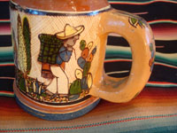 Mexican vintage pottery and ceramics, a set of four mugs with petatillo backgrounds and wonderful artwork, attributed to the famous artist, Balbino Lucano, Tlaquepaque, Jalisco, c. 1930. Photo showing the second campesino on one Tlaquepaque pottery mug.