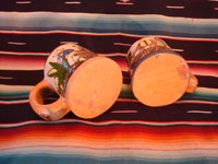 Mexican vintage pottery and ceramics, a set of four mugs with petatillo backgrounds and wonderful artwork, attributed to the famous artist, Balbino Lucano, Tlaquepaque, Jalisco, c. 1930. Photo showing the bottoms of two of the Tlaquepaque pottery mugs.