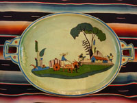 Mexican vintage pottery and ceramics, a spectacular oval tray or charger with handles, a wonderful pale-green background glaze, and very fine artwork, Tlaquepaque, Jalisco, c. 1930's. Main photo of the tray.