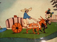 Mexican vintage pottery and ceramics, a spectacular oval tray or charger with handles, a wonderful pale-green background glaze, and very fine artwork, Tlaquepaque, Jalisco, c. 1930's. Closeup photo of the Mexican campesino and his cart.