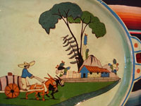 Mexican vintage pottery and ceramics, a spectacular oval tray or charger with handles, a wonderful pale-green background glaze, and very fine artwork, Tlaquepaque, Jalisco, c. 1930's. Photo showing the house under trees.