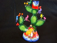 Mexican vintage pottery and ceramics, and Mexican vintage folk-art, a wonderful pair of trees-of-like, signed by the late, famous folk-artist, Alfonso Castillo, of Izucar de Matamoros, Puebla, c. 1990's. Front view of the tree-of-life featuring the dashing Mexican caballero.