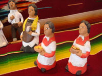 UU-3: Mexican vintage folk-art, and Mexican vintage pottery and ceramics, a wonderful and whimsical wedding scene filled with beautifully crafted pottery figures, by the very famous folk-artist, Josephina Aguilar of Acatlan, Oaxaca, c. 1960's. Photo of the two altar-boys.