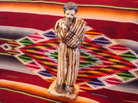 Mexican vintage folk-art, and Mexican vintage pottery and ceramics, a wonderful pottery statue of a Mexican caballero with a sarape gracefully draped over his shoulder and wearing a wonderful striped suit, attributed to the great folk-artist, Senora Pena of Tzintzuntzan, Michoacan, c. 1960's. Main photo.