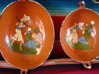Mexican vintage pottery and ceramics, a set of nesting oval bowls with beautiful artwork, Tonala or Tlaquepaque, Jalisco, c. 1940's. Closeup photo of two of the nesting bowls.
