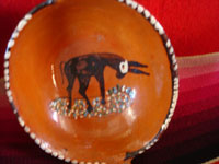 Mexican vintage pottery and ceramics, a set of nesting oval bowls with beautiful artwork, Tonala or Tlaquepaque, Jalisco, c. 1940's. Photo of the fifth and smallest bowl, showing the black burro on the front.