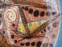 Mexican pottery and ceramics, a lovely charger with fantastic artwork, Tonala or Tlaquepaque, Jalisco, c. contemporary. Closeup photo of a butterfly on the front of the charger.