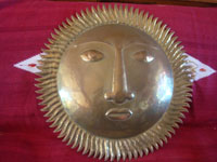 Mexican vintage tinwork art (tin art), and Mexican vintage folk art, a large figure of the sun made of copper-dipped brass, c. 1950.  Main photo of the copper-dipped sun.