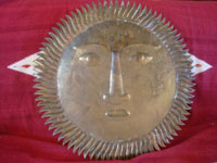 Mexican vintage tinwork art (tin art), and Mexican vintage folk art, a large figure of the sun made of copper-dipped brass, c. 1950.  Photo showing the back of the copper sun.