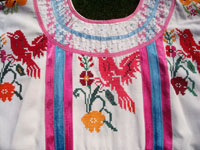 Mexican vintage textiles and sarapes, and Mexican vintage huipiles and blouses, a stunningly beautiful huipil from the state of Oaxaca, with very fine embroidery and vibrant colors, Oaxaca, c. 1950. Closeup photo of the beautiful birds embroidered on the front of the huipil.