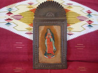 Mexican vintage devotional art, and Mexican vintage tinwork art (tin art), a beautiful retablo depicting Our Lady of Guadalupe, Patroness of the America's, painted on tin and mounted in a wonderful stamped tin nicho or frame, c. 1930's. Main photo of the retablo.