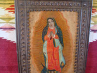 Mexican vintage devotional art, and Mexican vintage tinwork art (tin art), a beautiful retablo depicting Our Lady of Guadalupe, Patroness of the America's, painted on tin and mounted in a wonderful stamped tin nicho or frame, c. 1930's. Closeup photo of Our Lady of Guadalupe.