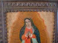 Mexican vintage devotional art, and Mexican vintage tinwork art (tin art), a beautiful retablo depicting Our Lady of Guadalupe, Patroness of the America's, painted on tin and mounted in a wonderful stamped tin nicho or frame, c. 1930's. Another closeup photo of the face of Our Lady.