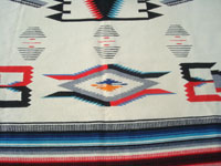 Mexican vintage textiles and serapes, and New Mexican vintage textiles, a very beautiful and finely woven textile from the weaving center of Chimayo, New Mexico, c. 1940. Photo showing another part of the Chimayo textile, below the center medallion.