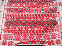 Mexican vintage Musco huipil from the state of Oaxaca, with very fine hand-embroidery. It is of very fine and soft cotton, with analyn-dyed yarn in the embroidery. Another closeup photo of the fine embroidery of the Musco huipil.