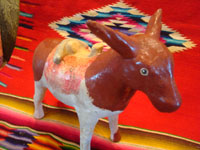 Mexican vintage folk art, and Mexican vintage pottery and ceramics, a wonderful pottery figure of an endearing donkey, Tonala or Santa Cruz de las Huertas, Jalisco, c. 1940's. A side view of the pottery donkey.