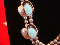Mexican vintage sterling silver jewelry, and Taxco sterling silver jewelry, a beautiful necklace, linked with lovely silver spheres, and of sterling silver with beautiful pale-blue turquoise, Taxco, c. 1940's.  Closeup photo of the four medallions on the sides of the necklace.