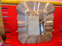Mexican vintage tin-art, a beautiful tinwork art mirror, Oaxaca, c. 1950's. Main photo of the tinwork art mirror.