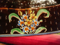 Mexican vintage pottery and ceramics, a stunning pottery bowl with a beautiful black background and a starry night pattern, and highly intricate artwork decorations, Tonala or San Pedro Tlaquepaque, c. 1920-30's. Closeup photo of the floral border.
