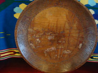 Mexican vintage folk art, and Mexican vintage woodcarvings and masks, a beautiful carved wooden batea, signed B. Olivares, with an incised scene of a lovely woman at the floating gardens of Xochimilco, Mexico City, 1940's. Main photo of the batea.