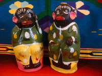 Mexican vintage folk art, and Mexican vintage pottery and ceramics, a pair of pottery monkeys in colorful dress, made to hold wonderful mezcal, Oaxaca, c. 1950's. Main photo of the monkey bottles.