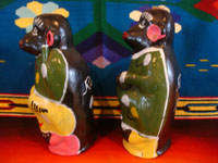 Mexican vintage folk art, and Mexican vintage pottery and ceramics, a pair of pottery monkeys in colorful dress, made to hold wonderful mezcal, Oaxaca, c. 1950's. Photo showing a side shot of the monkeys.
