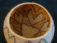 Native American Indian baskets, a stunning Mission basket, Cahuilla, Palm Springs area, c. 1920. Photo of the basket shot from above and looking down at the inside of the Cahuilla Indian basket.