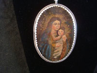 Mexican vintage devotional art, and Mexican vintage sterling silver jewelry, a beautiful relicario with the small retablo beautifully painted on tin, with a lovely sterling silver rope chain, c. 1920's.  Closeup photo of the second side of the relicario.