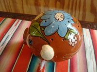 Mexican vintage pottery and ceramics, a wonderful pottery pig with fine artwork, Tonala or San Pedro Tlaquepaque, c. 1940's. A side view of the pig.