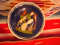 Mexican vintage pottery and ceramics, and Mexican vintage folk art, a pottery plate from Tlaquepaque, Jalisco, with a wonderful scene of a fox and beautiful bird (a quetzal), on a dark blue slip, c. 1930-40. Main photo.