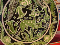 Mexican vintage pottery and ceramics, and Mexican vintage folk art, a fantasia pottery plate from Tlaquepaque, Jalisco, c. 1930-40. The artwork on the plate features two lovely deer, one with great horns, amidst flowers and foliage. Closeup of the center of the plate.