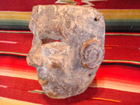 Mexican vintage wood-carving and vintage folk art, a carved wooden mask from Puebla, 1930 or earlier. The mask is from the Danza de Abonicos (Dance of the Fans), and originates from Huauchinango, in the state of Puebla. Side view of the Puebla mask.