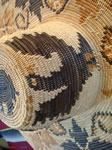 Native American Indian basket, a fantastic basketry hat by the famed contemporary basket-weaver, Abe Sanchez, from California, c. 1990. Closeup photo of an eagle woven into the Indian basketry hat.