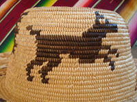 Native American Indian basket, a fantastic basketry hat by the famed contemporary basket-weaver, Abe Sanchez, from California, c. 1990. Closeup photo of a wonderful doggie woven into the Indian basket hat.